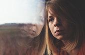 A woman in train alone and sad