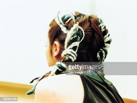 Woman in two plaits, rear view : Stock Photo