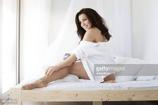 Woman in underwear in the bedroom. Debica, Poland