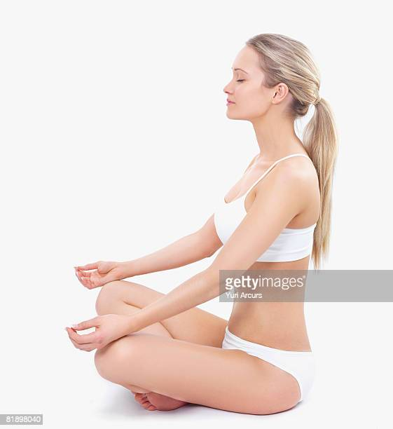 Woman in underwear meditating