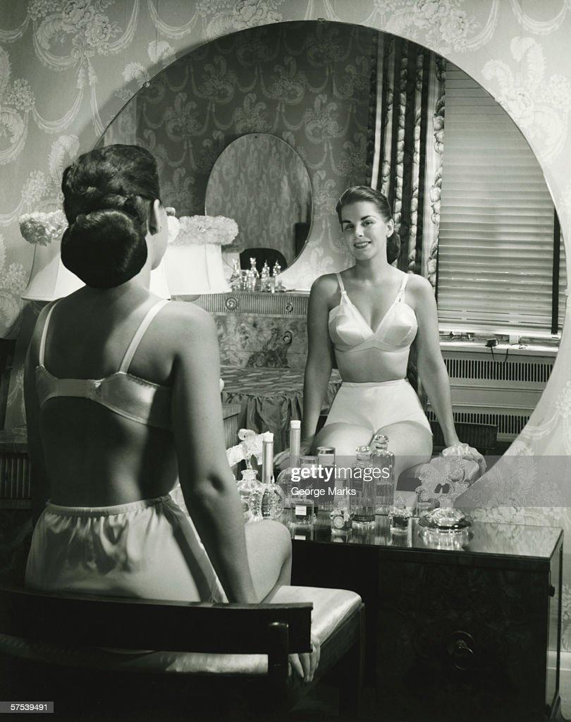Woman In Underwear Sitting In Front Of Vanity Table Rear