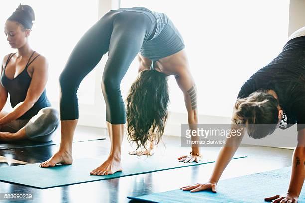 Woman in upward bow pose in yoga studio