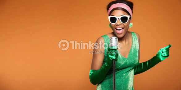 6552c7543b34 A Woman In Vintage Attire Singing Soul Funk In A Microphone Stock ...