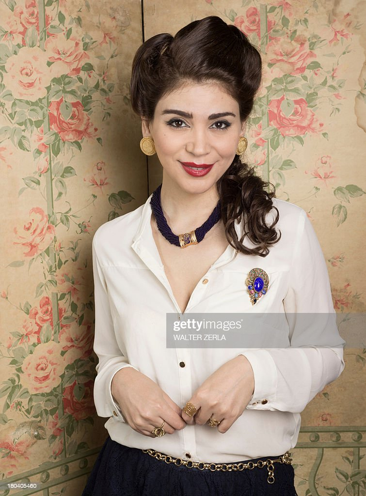 Woman in vintage clothes standing in corner : Stock Photo