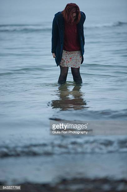 Woman in water deep to her ankles
