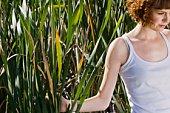 Woman in wetlands reeds