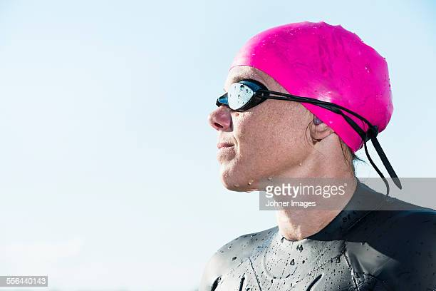 Woman in wetsuit looking away