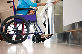 Woman in wheelchair at ticket counter