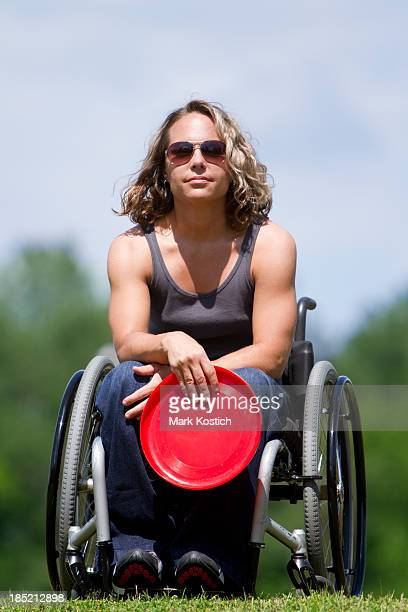 Woman in Wheelchair with Flying Disc