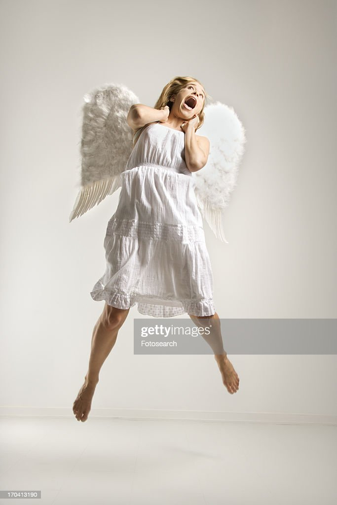 Woman In White Angel Costume Jumping In Air Stock Photo ...