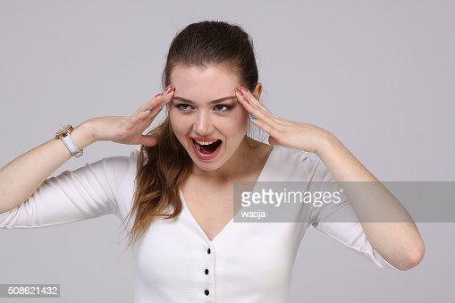 woman in white dress shouts : Stock Photo