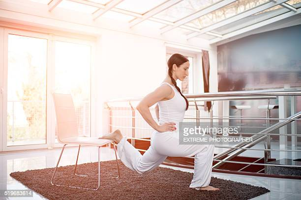 Woman in white exercising lunges