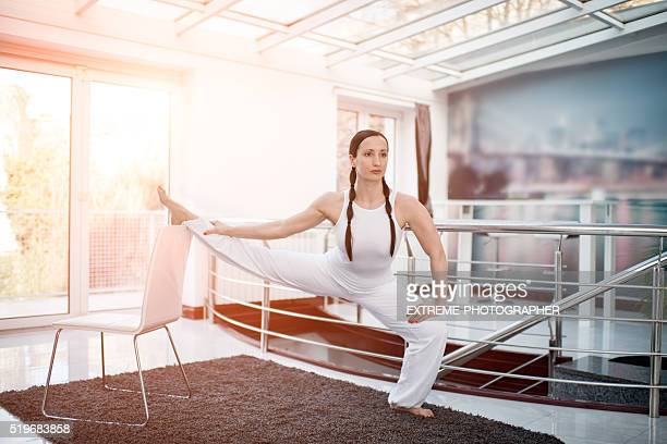 Woman in white stretching legs
