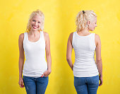 Woman in white tank top on yellow background