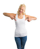 Woman in white tank-top pointing at it