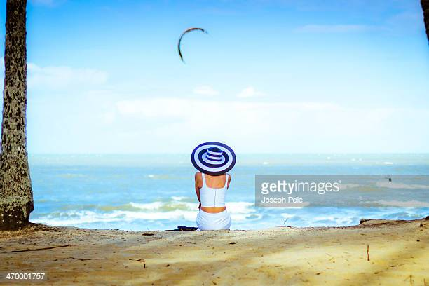 Woman in White with Large Hat Watching Kite Surfer