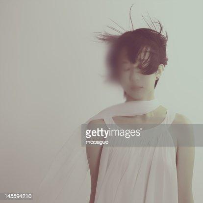 Woman in wind : Stock Photo