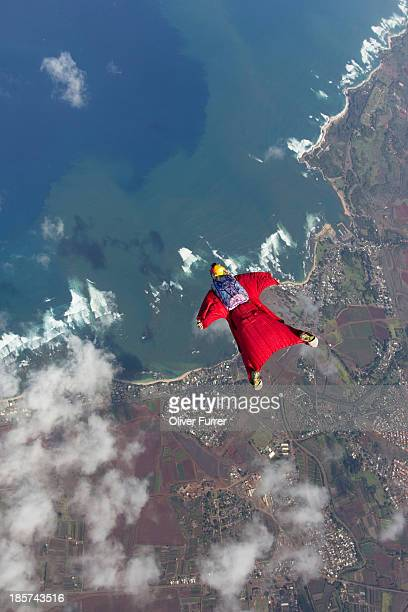Woman in wingsuit flying above Honolulu,  Hawaii