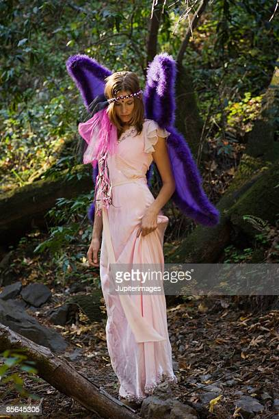 Woman in woods wearing fairy costume