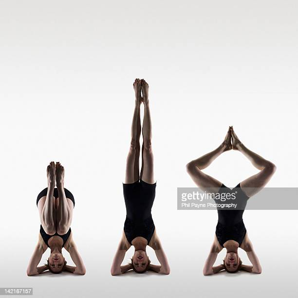 Woman in yoga headstand positions