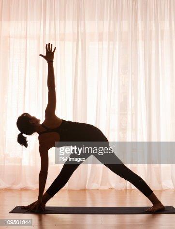 Woman in Yoga pose, silhouette
