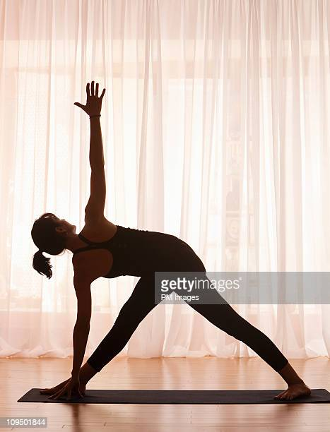 Woman in Yoga pose, silhouette