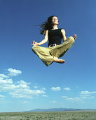 Woman in yoga position in mid air