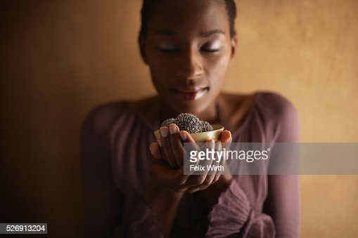 Woman indulging in chocolates : Stock Photo