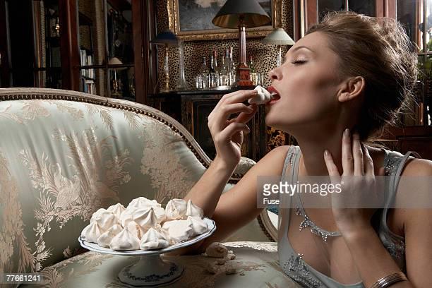 Woman Indulging in Dessert