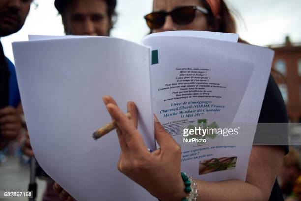 A woman informs a passeby while smoking marijuana For the Global Marijuana March supporters of legalization for medical and recreationnal use run a...