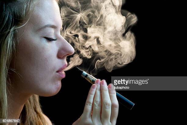 Woman inhaling from an electronic cigarette