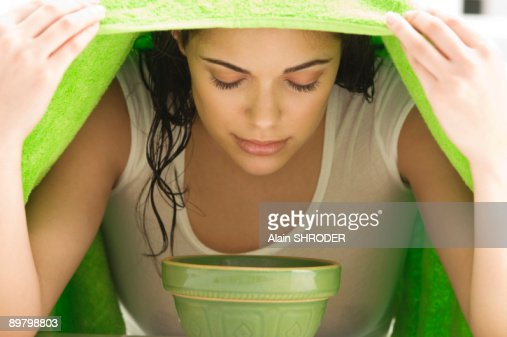Woman inhaling over a bowl