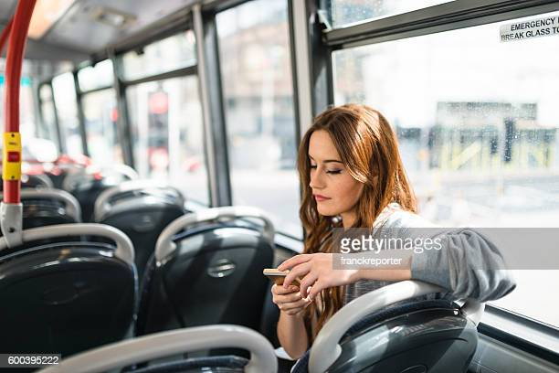 woman inside a bus in london on the phone