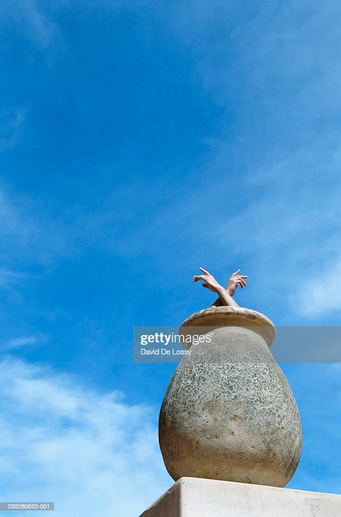 Woman inside clay pot, low angle view