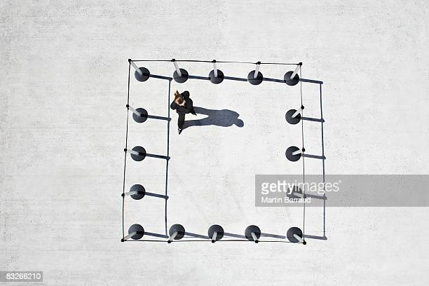 Woman inside cordon posts