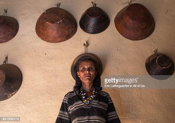 Woman inside her house decorated with leather baskets in a traditional Argoba stone houses village on January 12 2017 in Koremi Ethiopia