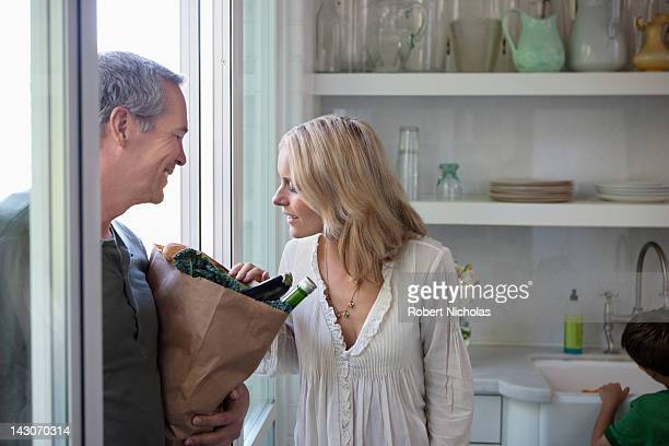 Woman inspecting husband's groceries