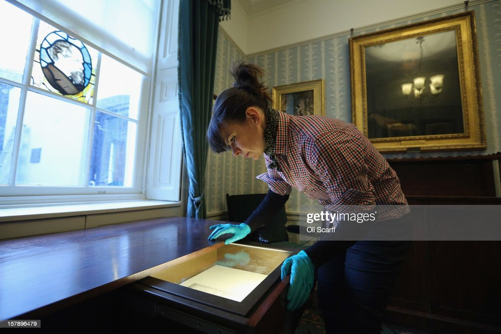 A woman inspects Dickens' marriage certificate in the Morning Room inside the Charles Dickens Museum on December 7, 2012 in London, England. The museum will re-open to the public on December 10, 2012 following a major 3.1 million GBP refurbishment and expansion programme to celebrate Dickens' bicentenary year. The museum is located in Charles Dickens' house on Doughty Street where he lived from 1837 until 1839 and in which he wrote many novels including Oliver Twist and Nicholas Nickleby.
