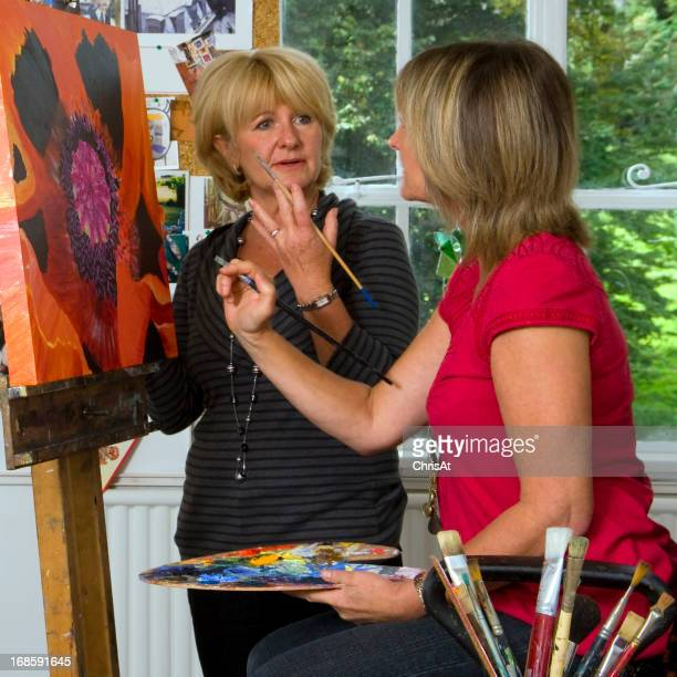 Woman instructing student in a fine arts class