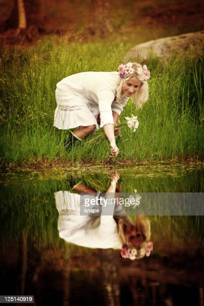 Woman inte by the pond