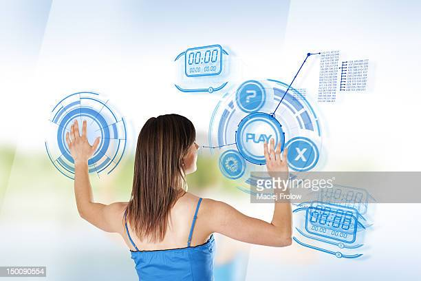 Woman interacting with a touch screen on glass