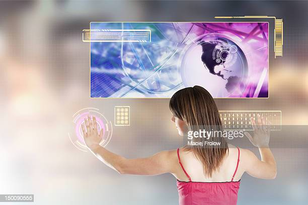 Woman interacting with a wall touch screen