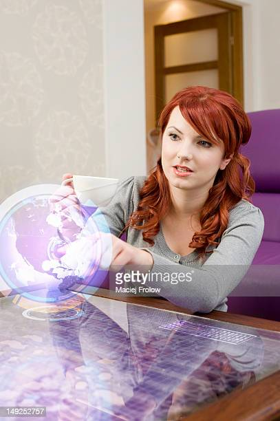 Woman interacting with big 3d screen