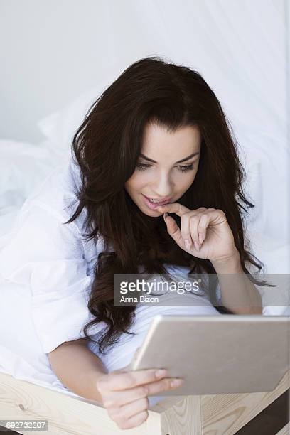 Woman interested in browsing digital tablet. Debica, Poland