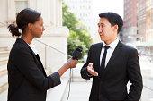 Woman Interviews Man