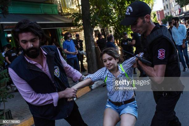 A woman is arrested by police after gathering to support the LGBT Pride March on June 25 2017 in Istanbul Turkey The 2017 LGBT Pride March was banned...