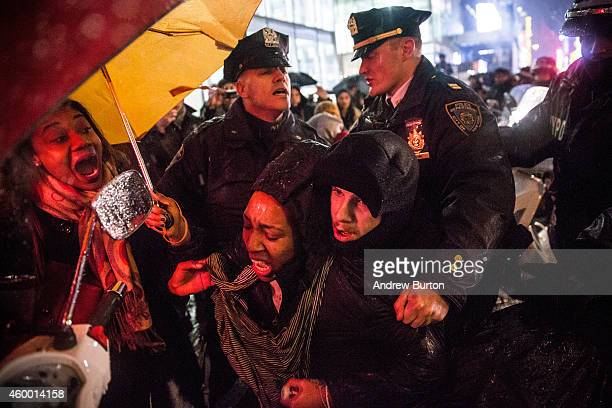 A woman is arrested by police while protesting the Staten Island New York grand jury's decision not to indict a police officer involved in the...