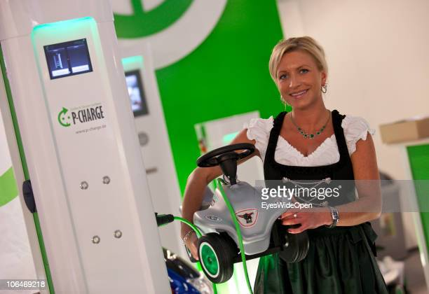 A woman is charging a bobby car for kids during the eCarTec 2010 the 2nd International trade fair for electric mobility at the New Munich Trade Fair...