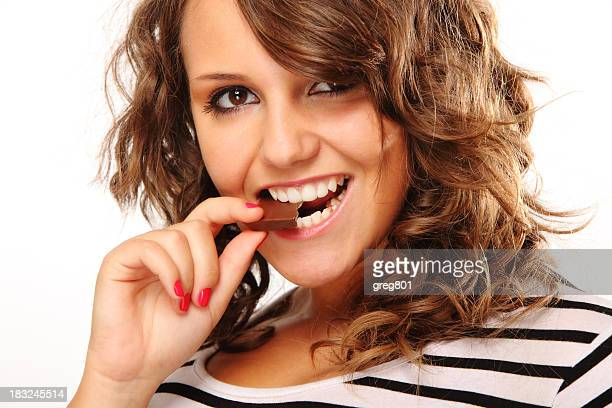woman is chewing slice of the chocolate  Size XXXL