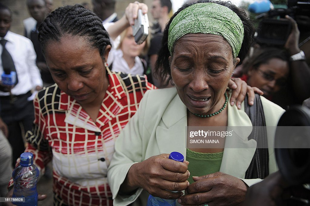 A woman is comforted by a relative on September 25, 2013 after indentifying the body of her son at the city mortuary in Nairobi. Kenyan troops and rescue workers scoured the wreckage of a Nairobi shopping mall on September 25 for bodies and booby-trapped explosives after a four-day siege by Islamist gunmen left 67 dead and dozens more missing. In one of the worst attacks in Kenya's history, the militants marched into the four-storey, part Israeli-owned mall at midday on September 21, spraying shoppers with automatic weapons fire and tossing grenades.